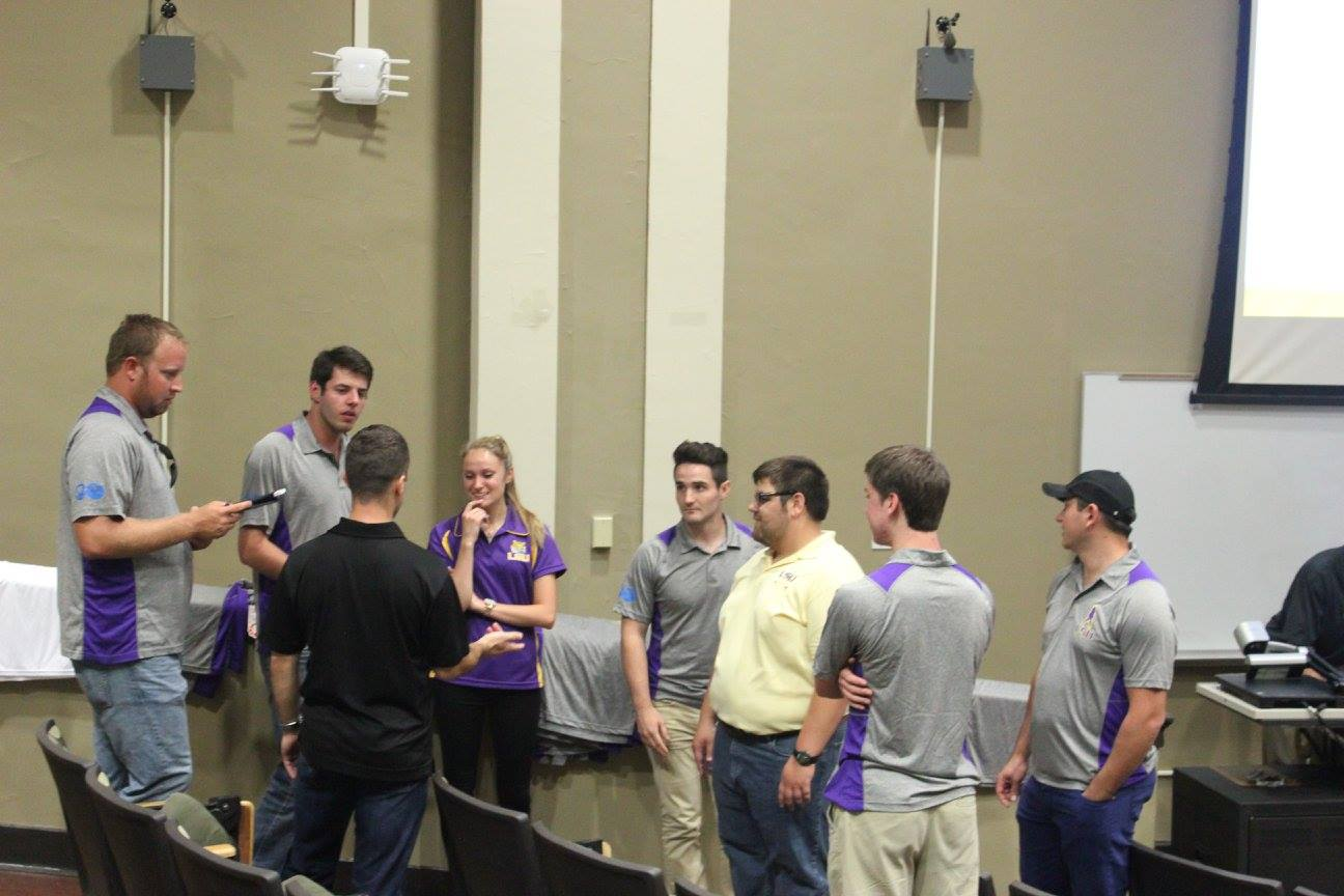 SPE officers talk before the meeting
