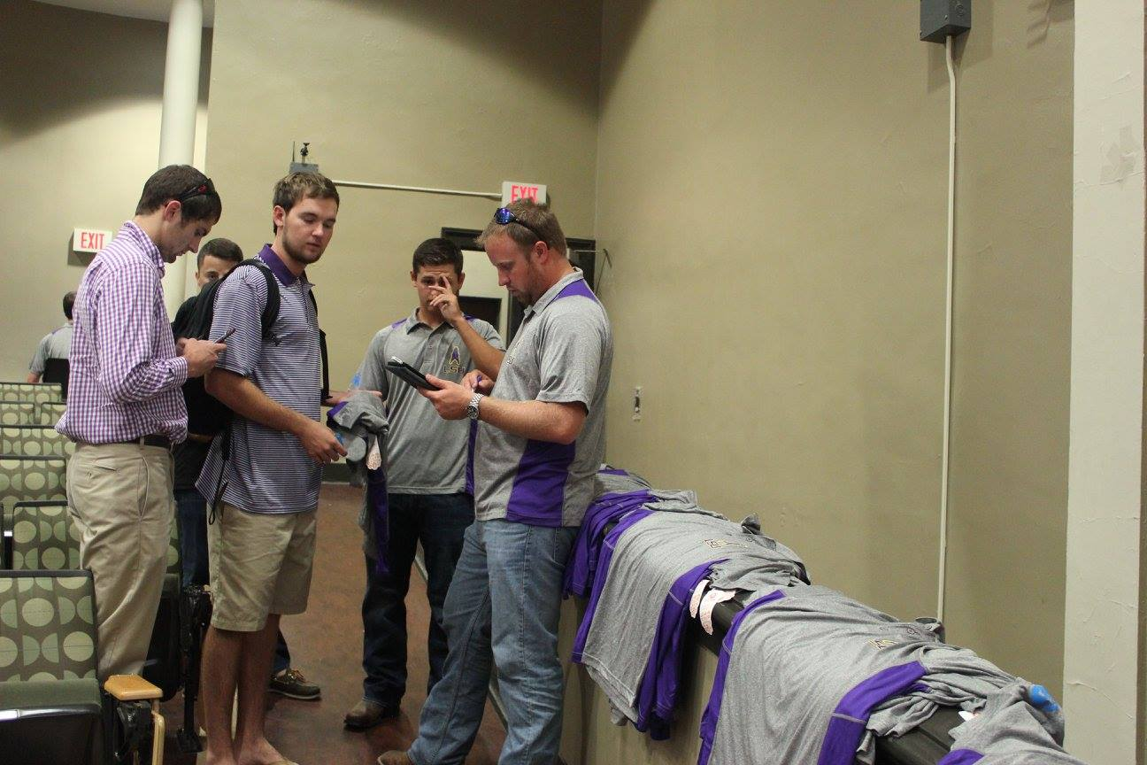 Michael Formby sells SPE shirts to students