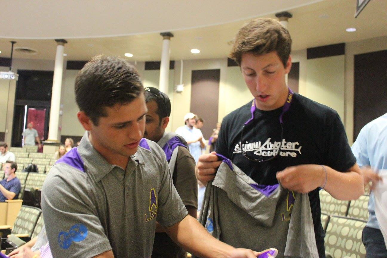 Mylan Perrin sells an SPE shirt to a student